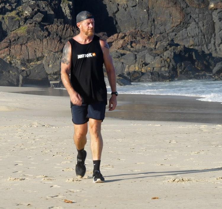 Shaun O'Gorman walking on the beach