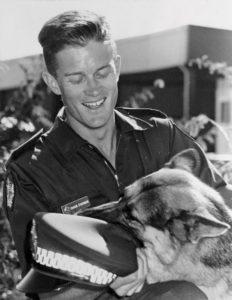Shaun O'Gorman as a dog handler